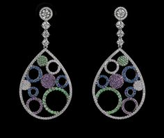 """Colored """"Jaimy"""" earrings - The boldly contrasting colors of these circles in a pair drop earrings allow them to be whimsical yet incredibly chic combining, diamonds, sapphires, amethysts, and tsavorite garnets for a total of 627 stones."""