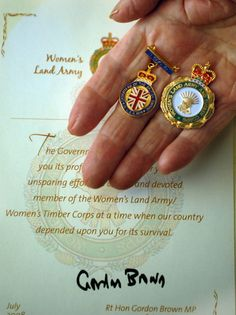 """WLA commerative medals. According to Nicola Tyrer's 1996 history, """"They Fought in the Fields: The Women's Land Army,"""" after the war, Winston Churchill vetoed the inclusion of the WLA in the demobilization grants to women who served in the military. Thirty years later, Tyrer wrote, the WLA was denied permission to march in a WWII remembrance procession.  In 2008, the British government finally recognized the WLA by awarding these service badges."""