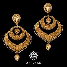 """Pad-Pineapple Kanbala: A conventional kanbala gets a swinging arch of an envelope, bordered by a continuous series of matchsticks. Created entirely by hand in soft yellow 22K gold and given a rustic finish and polish, this dressy earring may well not push """"Pen-Pineapple-Apple-Pen"""" off the charts but it certainly allowed us to put together lotuses, matchsticks and pineapples in a certain order that shaped up into an attractive, carefree kanbala. Wear it; have fun; and dance if you like."""