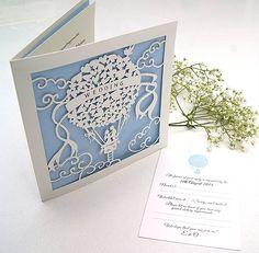 A laser cut Up & Away balloon wedding invitation.