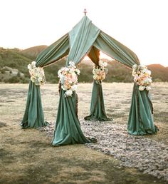 Fabric draping ceremony tent backdrop Photo: On the Go Bride