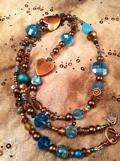Love these colors: dark blue and copper.  The heart accent beads are beautiful, but could be any shape really. I'd want this one to be long.
