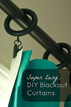 Transform fabric or curtain panels into blackout curtains with this super easy no sew project!
