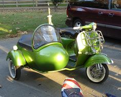 Oh, hell yeah!  limegreen vintage vespa motorscooter with sidecar by Royal Enfield, via Flickr