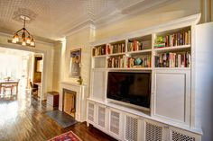 Fancy White TV Cabinet Design in Eclectic Family Room with Blind . Built In Tv Cabinet, White Tv Cabinet, Tv Cabinet Design, Built In Cabinets, Tv Cabinets, Cabinet Doors, Custom Cabinets, Bookshelves With Tv, Fireplace Bookshelves