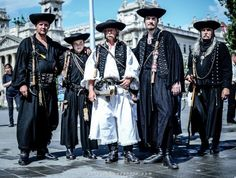 Hungarian men in their traditional costumes.