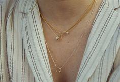 Pendiente flecha Ouibyou y piercings varios Sansoeurs, collar con brillante Tiffany & Co, collar Ouibyou y collar Sansoeurs