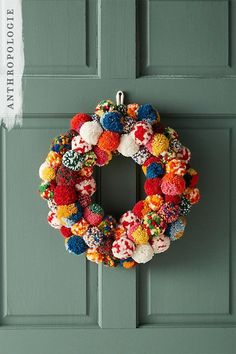 Christmas decorations with a pop of color | Pom Society Wreath | Shop Anthropologie Holiday Decor