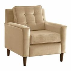 Button-tufted arm chair with foam cushioning. Handmade in the USA.  Product: ChairConstruction Material: Solid pine, polyurethane, velvet and polyester fill foamColor: BuckwheatFeatures:  Button-tufted Handmade in the USA Dimensions:  H x  W x  D