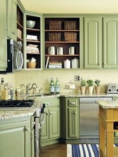 Would I be brave enough to paint my cabinets this color?!  I used to hate green now it's growing on me and becoming one of my fav colors!