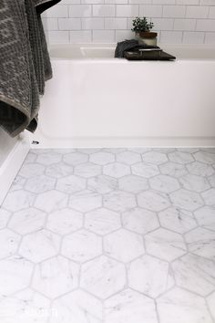 bathroom flooring Loving the modern look of this marble hexagon pattern tile with gray grout! It adds so much character to this farmhouse bathroom! Its a medium sized tile floor in the 5 inch size and comes on a mosaic. Diy Bathroom Decor, Bathroom Interior Design, Bathroom Art, Bathroom Ideas, Marble Bathroom Floor, Best Bathroom Flooring, Marble Look Tile, Small Bathroom Tiles, Tile Flooring