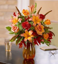 Fall Grandeur: A symphony of autumn color, this many-splendored floral arrangement makes an unforgettable gift for any occasion or Thanksgiving.