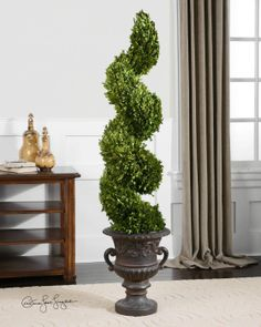 Uttermost   Preserved Boxwood, Spiral Topiary  Item #60094    Preserved while freshly picked, natural evergreen foliage looks and feels like artfully sculpted, living boxwood planted in an aged black urn with rust brown glaze.  Designer: 	Constance Lael-Linyard  Dimensions: 	13 W X 59H X 13 D (in)  Weight (lbs): 	42  Ship Via UPS: 	Yes  UPC Number: 	792977600948