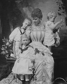 The Duchess of York (later Queen Mary) , Prince Edward (Later Edward VIII, the Duke of Windsor), Prince Albert (later George VI) and Princess Mary, circa 1900