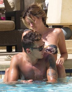 Relaxed: Gunners star Ozil has been spending time with his girlfriend Mandy Capristo in La...