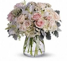 Soft as a whisper, this elegantly feminine vase of delicate pink and white roses, hydrangea and lilies is a simple and heartfelt affirmation of love and devotion. #GiveFlowers