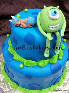 Monsters Inc. Blue polka-dot fondant custom unique two tier baby shower cake with edible monster and baby topper