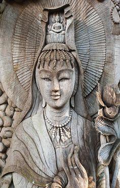 Kuan Yin in wood .Picture by Apatsara Sirirodchanapanya