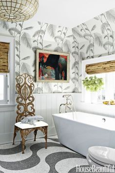 Pattern Play: This spa-inspired New Jersey-based bathroom by Colleen Bashaw isn't afraid of a little pattern play. Cole & Son's Palm Leaves wallpaper creates a tropical vibe, without overwhelming the space with color. Click through for more gorgeous gray bathrooms!
