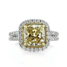 4.04ct Fancy Light Brown Yellow Cushion Cut Diamond Engagement Ring available at Markbroumand.com!