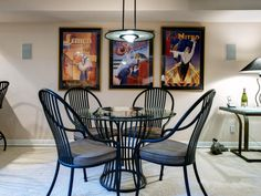 What was once a boring basement is now a cozy man cave, perfect for card games and casual entertaining. A contemporary black dining set and a series of framed prints by Michael Kungl create a relaxed atmosphere.