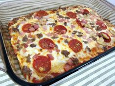 No dough pizza. Crust: 1 (8oz) pkg cream cheese, 2 eggs, 1/4 tsp ground black pepper, 1 tsp garlic powder, 1/4 cup grated Parmesan. Mix and spread in greased 9x13 dish. Bake @ 350 for 12-15 min or until golden brown. Cool 10 minutes Top with 1/2 cup pizza sauce, 1 1/2 cups mozzarella, and toppings. Bake 8-10 minutes until cheese is melted.