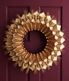 This paper cone gratitude wreath is made from simple materials, such as shafts of wheat and brown construction paper, but when assembled, looks surprisingly sophisticated.