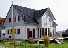 modern detached house made of wood with external fireplace, wooden house, Aumann Ha … - All About Decoration
