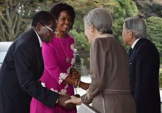 Emperor Akihito Photos - Japanese Emperor Akihito (R) and Empress Michiko (2nd R) greet Zimbabwean President Robert Mugabe (L) and his spouse Grace Mugabe (2nd L) upon their arrival at the Imperial palace in Tokyo on March 28, 2016. .Mugabe is on a five -day visit to Japan. / AFP / KAZUHIRO NOGI - Zimbabwe's President Mugabe on Official Visit to Japan