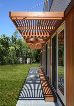 MODERN MODULAR Prefab Home with Brise Soleil Cantilevered Sunscreen and Metal Grating over Lighting at the Suburban Villa in Bethesda MD by Resolution: 4 Architecture Pergola Designs, Patio Design, Exterior Design, House Design, Flat Roof House, House Front, Outdoor Pergola, Backyard Patio, Modern Prefab Homes