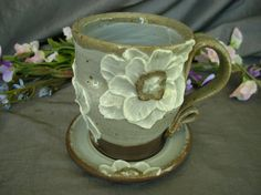 Ceramic Teacup and Saucer with Poppy Flowers in Summer White and Black Mountain by Sally Anne Stahl. www.clayshapergallery.com
