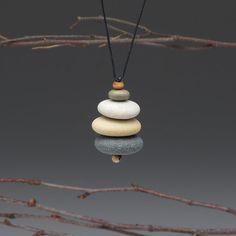 cairn:  beach stones + cotton cord
