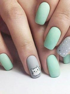Mint and grey is such a cute color combo! I'll definitely have to try that in the future. The little kitty just completes the whole look. Adorbs! :3