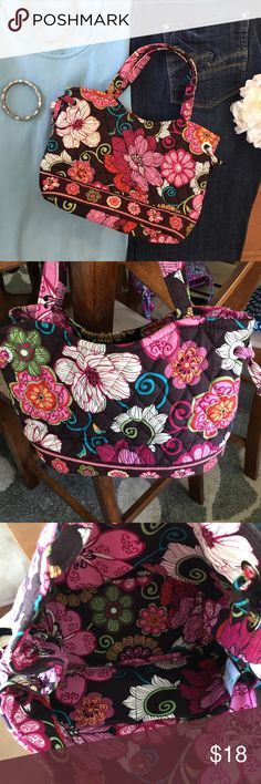 Vera Bradley purse pink and brown floral print Vera Bradley purse pink and brown floral print. Smoke free dog friendly home. Strap drop is 5 inches. EUC no holes or stains. Vera Bradley Bags