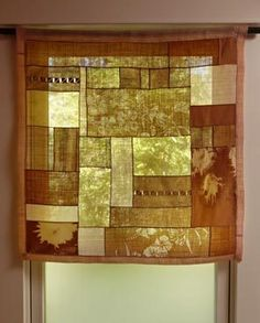 Pojagi, Korean-style patchwork, used for a window covering. I especially like the inclusion of translucent pieces.