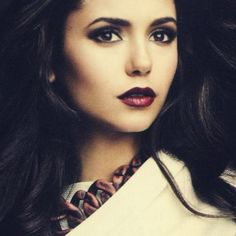 Nina Dobrev.  Love the dark shadow and red lipstick.  For those nights when you're feeling a little sultry :) <3