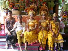 This wedding party has the look of a traditional Bali wedding, complete with elaborate head pieces