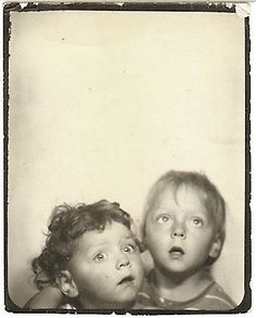 Two little googly-eyed kids with their mouths open looking up. It looks like they're both looking at different things.