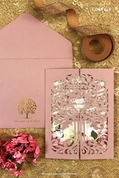 Old rose coloured laser wedding invitation with a beautiful tree of life design. For more design ideas, visit www.rohanaparna.com ——————————————— #rohanaparnainvitations #weddinginvitations #weddingcards #indianweddingcard #reception #weddingcard #shaadi #shaadicard#hinduweddingcard #mehendi #indianwedding #ecard #destinationwedding #weddingcards #royalwedding #laserweddingcard #lasercard #treeoflife Old Rose Color, Business Invitation, Indian Wedding Cards, Luxury Wedding Invitations, Life Design, Mehendi, I Card, Destination Wedding, Reception
