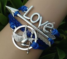games braceletsmockingjay pin by Multilayerjewelry on Etsy, $5.99