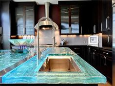 Hand poured glass countertops with led lights inside that change colors.  Looks really cool in person!