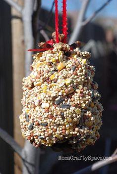 Early Spring Pine Cone Bird Feeder | AllFreeHolidayCrafts.com