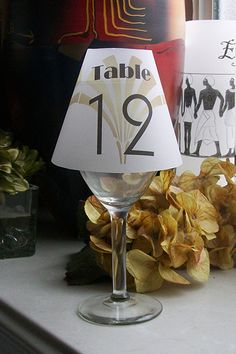Light up your table décor with luminaries. The vellum shades fit over a wine glass or champagne glass.