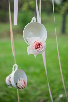 hanging teacups with flowers, photo by Matt and Ashley Photography http://ruffledblog.com/whimsical-wonderland-shoot #weddingideas