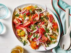 Heirloom Tomato Salad with Chicken and Couscous | Tomatoes are arguably the most exciting produce item to shop for at the farmer's market during the summer months. There's an endlessvarietyof colors, shapes, and sizes to be had. Assembling a simple salad with your market haul is the one of the easiest and most delicious (not to mention, beautiful)ways to enjoy to them all at once. Dress your tomato salad up with a simple vinaigretteand adorn it with fresh herbs anda sprinkling of…