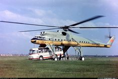 Helicopter lifting a bus - Russian Moscow 1968 Military Helicopter, Military Jets, Military Aircraft, Tandem, Pilot Humor, Aviation Humor, Magic School Bus, Last Minute Travel, Air Tickets
