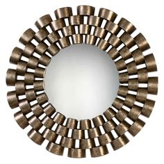 Take a good look at yourself in this contemporary round wall mirror.Made of staggered rows of enclosed tubing, with each row graduating in size the Uttermost Taurion Silver Leaf Round Mirror will be the focal point in any room or office.