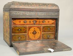 Mid-Eastern lacquered paint decorated lift top box with drop front, lower drop front section opening to six fitted drawer interior and top opening to reveal flamed mahogany interior.  ~ Realized Price $ 5,937.00
