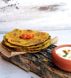 Savory Indian flat breads - Thepla served with fresh yogurt Raita and garlic pickle, a healthy and yum snack and travel food! >>> Looks yummy!