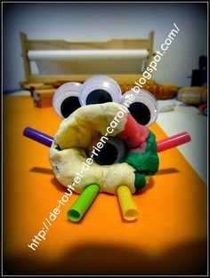 Play dough monsters with googly eyes and straws. Excellent for strengthening their little fingers!